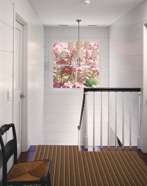 Tongue and Groove Siding Staircase Farmhouse with Chandelier Chandelier Shades Framed View Rush Seat Chair Striped