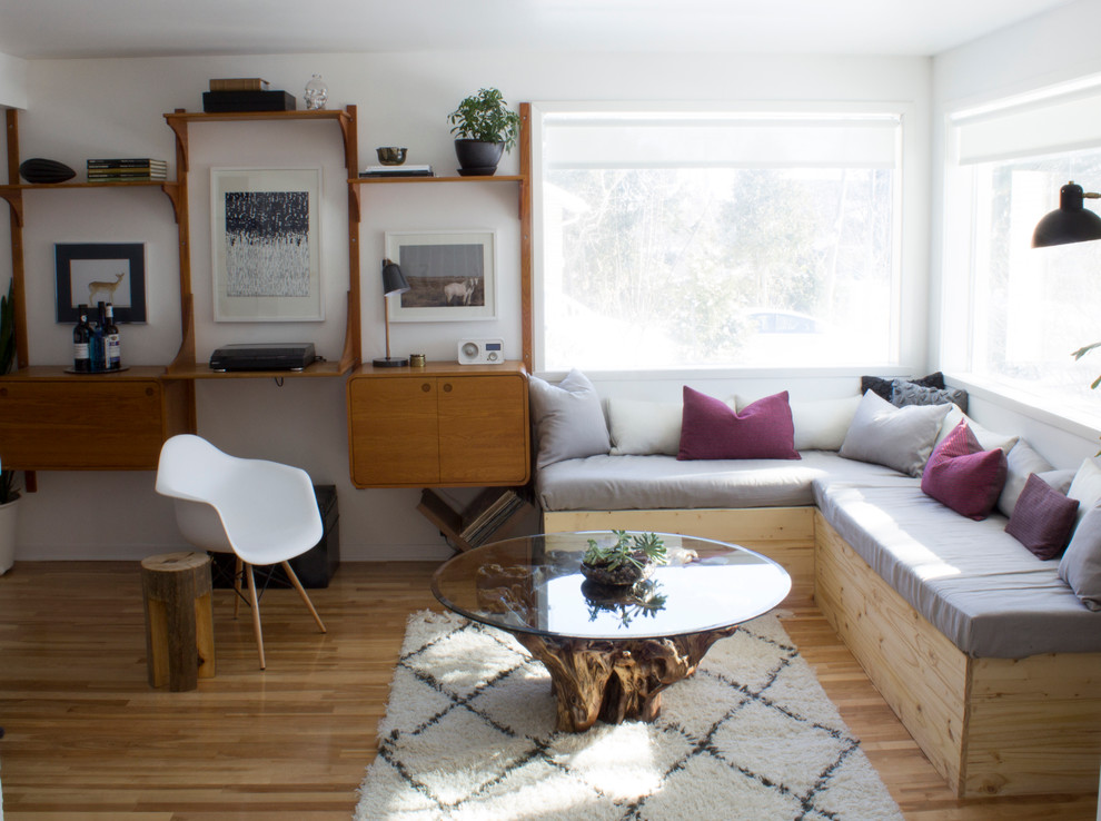 tree trunk coffee table Spaces Eclectic with banquette sofa beni ourain rug black planter