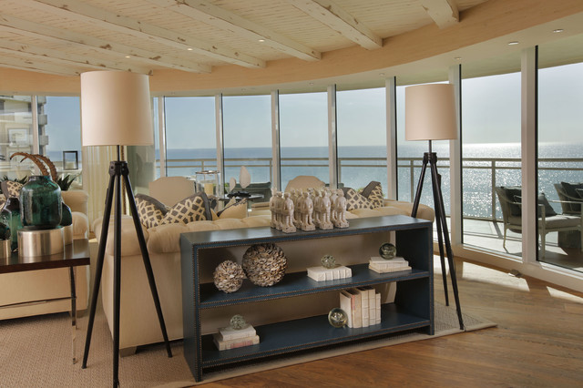 tripod floor lamp Living Room Beach with console table distressed wood glass panel railing Patio pillows