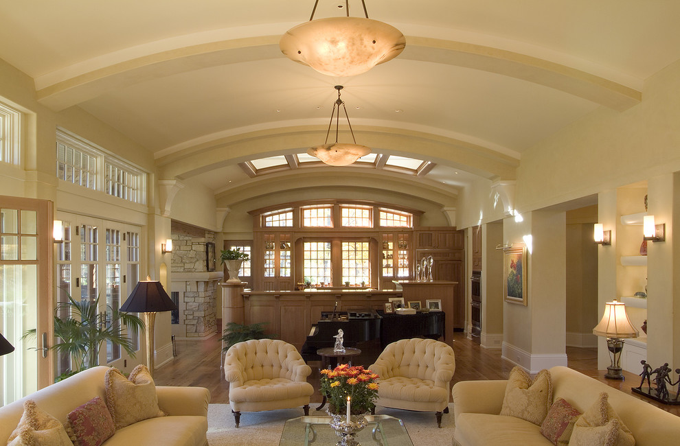 tufted armchair Living Room Traditional with area rug barrel vault baseboards bookshelves bowl