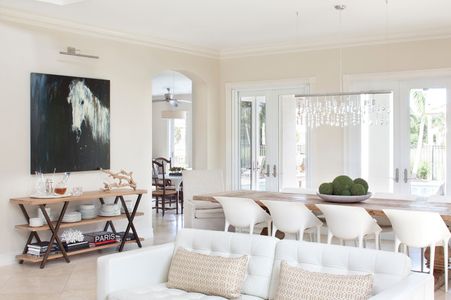 Tufted Leather Couch Dining Room Transitional with Arched Doorway Contemporary Art Crown Molding Double Doors French