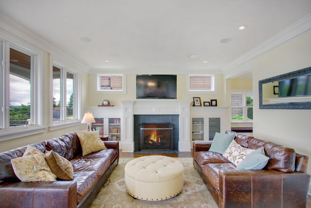 Tufted Leather Couch Living Room Craftsman with Area Rug Built in Bookcases Craftsman Crown Molding Fireplace