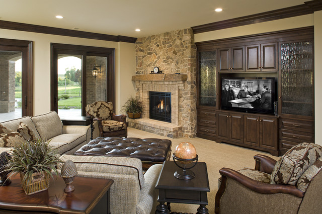 tufted leather ottoman Family Room Traditional with crown molding entertainment center fireplace mantel media storage stone