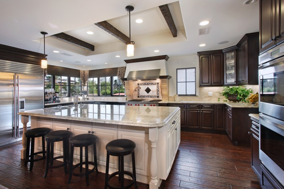 Tumbled Marble Backsplash Kitchen Mediterranean with Counter Stools Dark Stained Wood Falance Frame