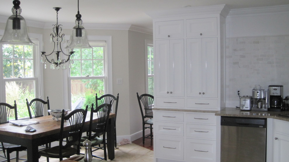 tumbled marble backsplash Kitchen Traditional with bay window bell pendant light black counters