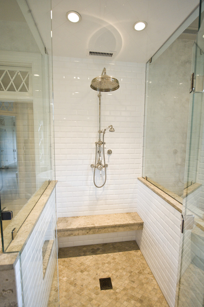 tumbled marble tile bathroom traditional with bench seat built in custom woodwork glass