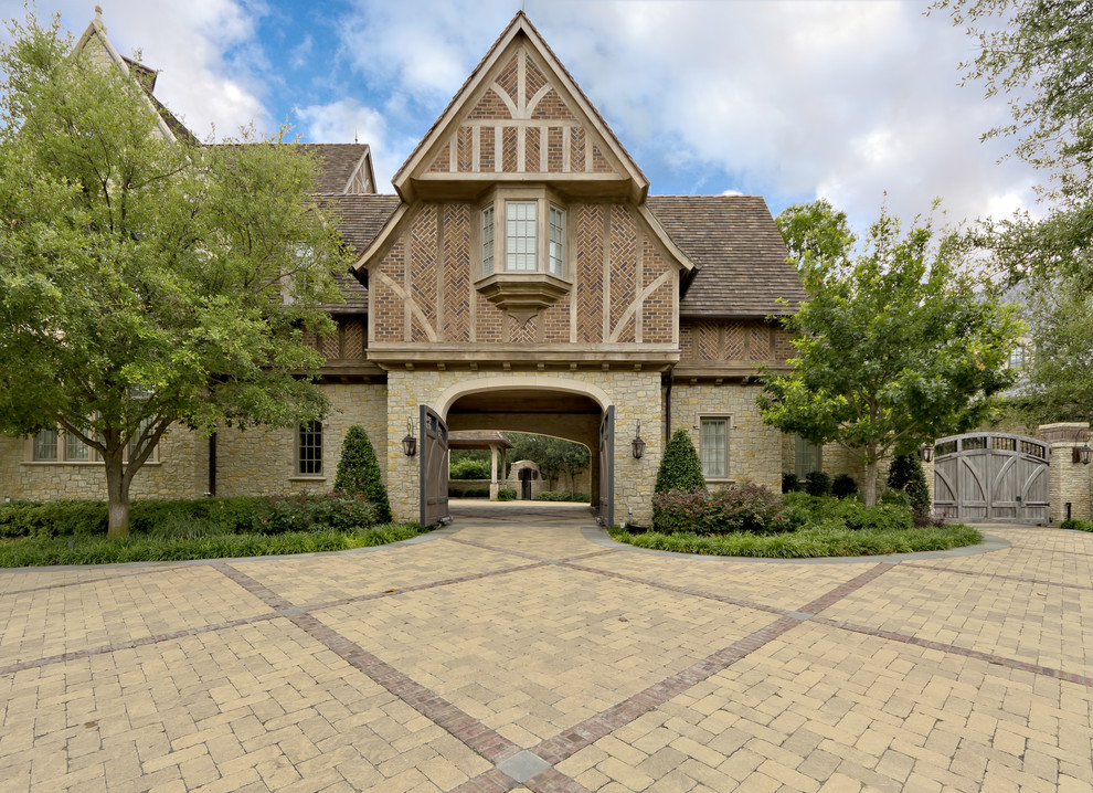Unilock Pavers Landscape Traditional with Brick Exterior Driveway Gable Roof Garden Gate