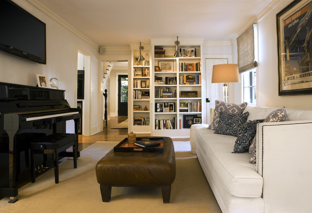 Upholstered Ottoman Family Room Traditional with Area Rug Bookcase Bookshelves Built in Decorative Pillows Leather