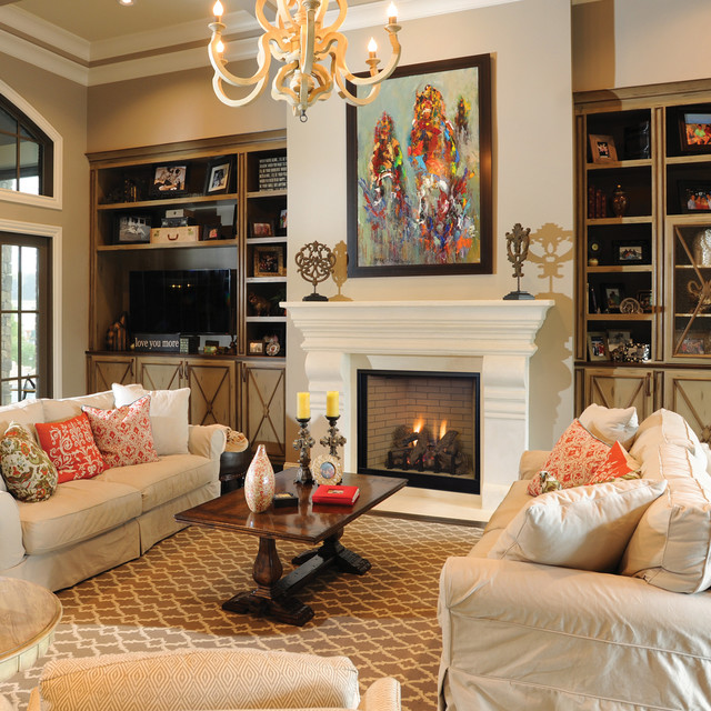 vented gas fireplace Living Room Traditional with built in cabinets chandelier crown molding framed art gas