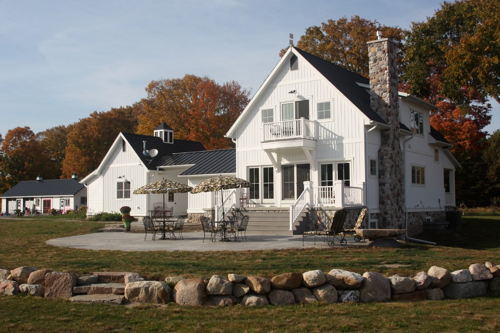 Vertical Siding Exterior Farmhouse with Balcony Cottage Craftsman Garden Seating Hardscape Lawn