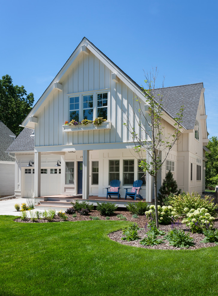 Vertical Siding Exterior Traditional with Bark Mulch Covered Porch Driveway Gable Roof