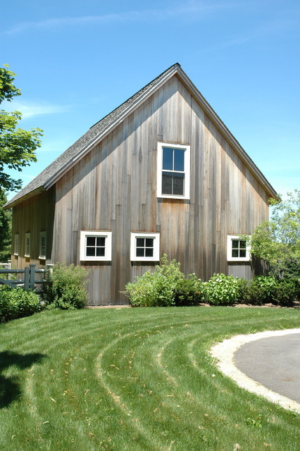 Vertical Vinyl Siding Garage and Shed Farmhouse with a Frame Barn Exterior Barn Siding Barnwood Bushes Country Grass