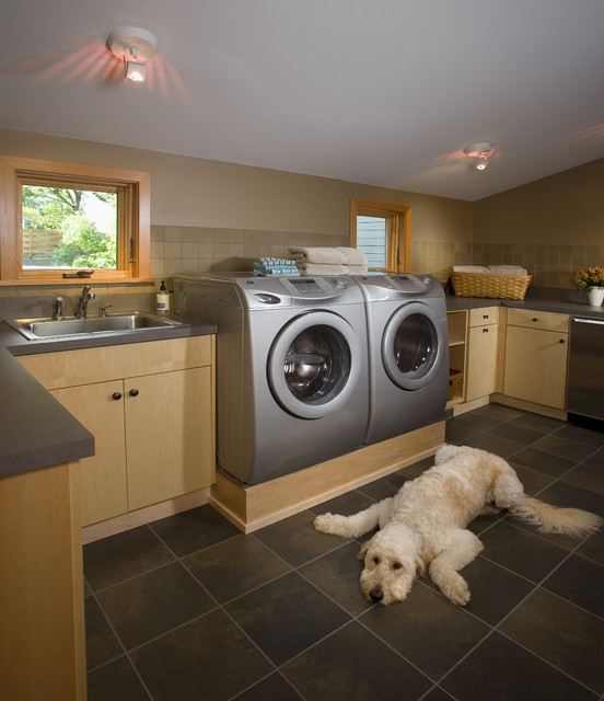 washer dryer pedestal laundry room contemporary with dark flooring dog light wood cabinets low ceiling platform - Flooring For Dog Room
