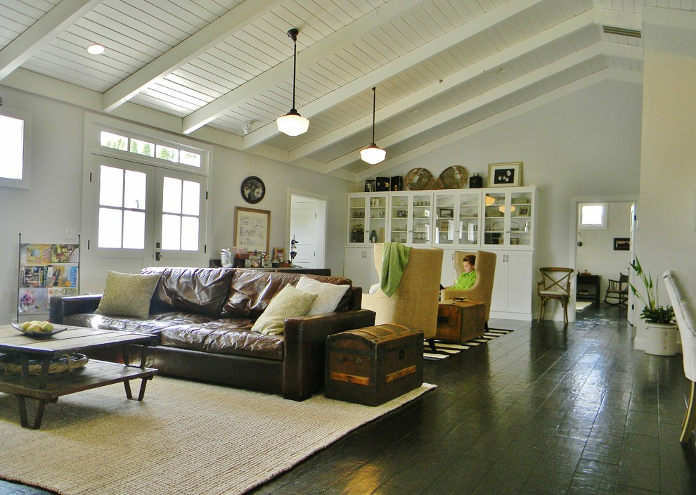 Wide Plank Flooring Family Room Farmhouse with Brown Leather Sofa Dark Wood Flooring Exposed1