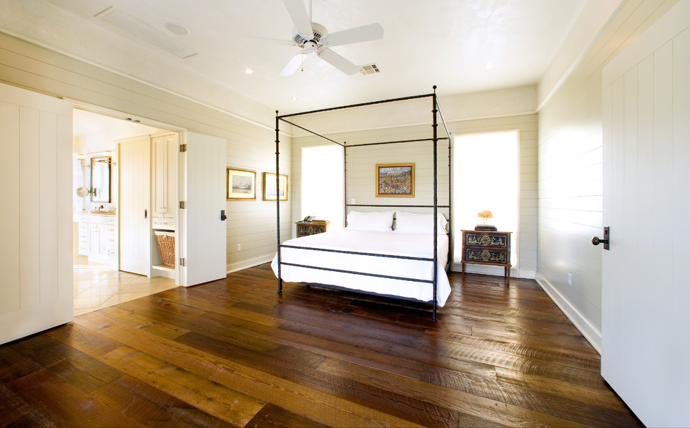 Wide Plank Laminate Flooring Bedroom Rustic with Baseboards Bedside Table Canopy Bed Carriage Doors