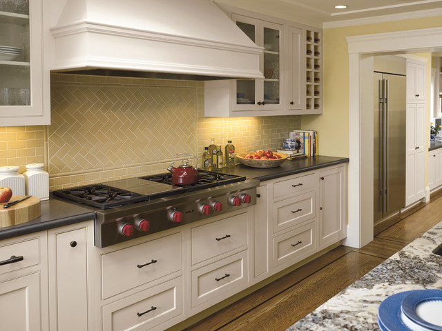 wolf cooktops Kitchen Traditional with backsplash black counter black hardware cream cubbies gas cooktop