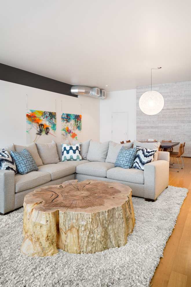 wood slab coffee table Living Room Contemporary with blue throw pillow colorful wall art driftwood
