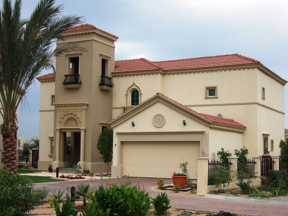 Wrought Iron Fence Exterior Mediterranean with Brick Paving Driveway Entrance Entry Neutral Colors