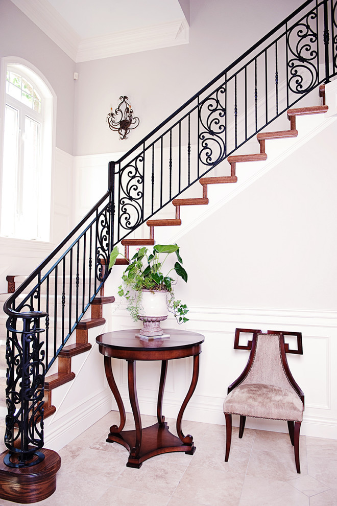 Wrought Iron Railing Staircase Victorian with Beige Side Chair Beige Stone Floor Beige