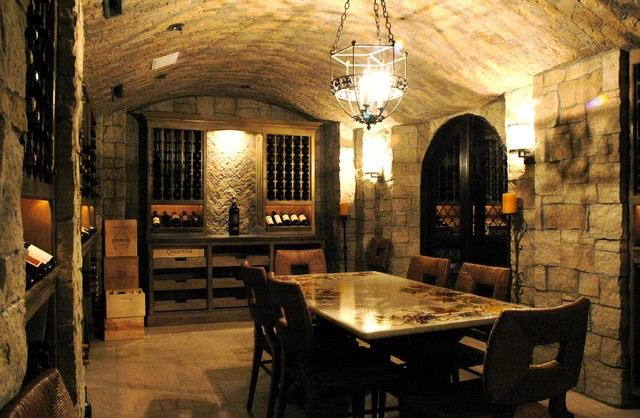 Wrought Iron Wine Racks Wine Cellar Rustic with Barrel Vault Candles Chandelier Neutral Colors Rustic Stone Flooring
