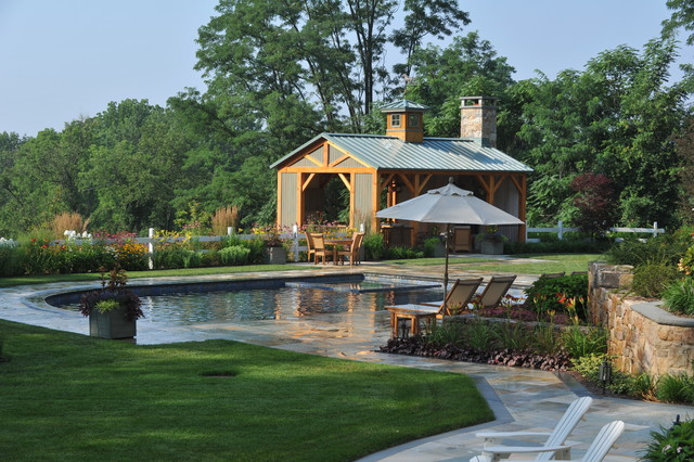 Building a Pole Barn Pool Farmhouse with Bluestone Container Plants Covered