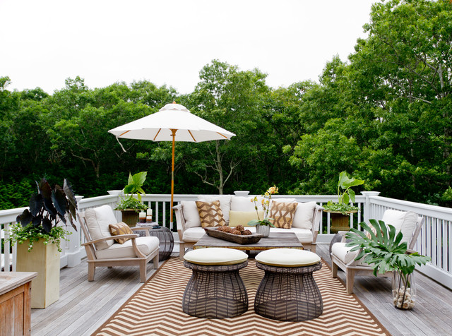 Dedon Furniture Deck Traditional with Brown and White Rug