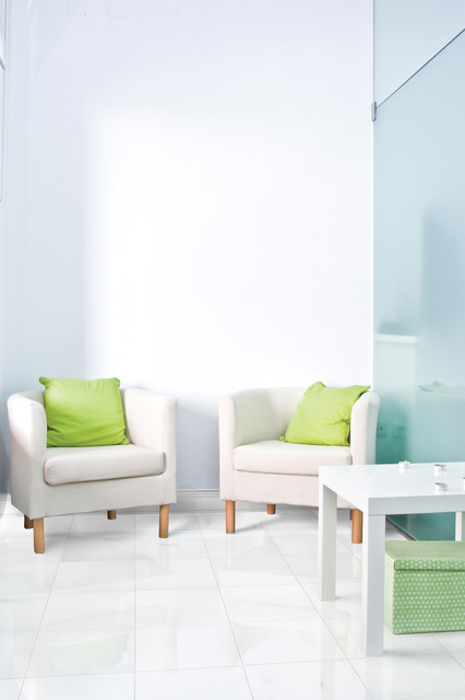 Lazy Susans Living Room with Cream Chairs Green Pillows