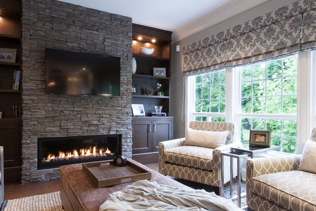 Majestic Fireplaces Family Room Traditional with Brown Ottoman Built in Bookcase