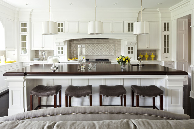 uttermost.com Kitchen Transitional with black floors brown Cabinetry