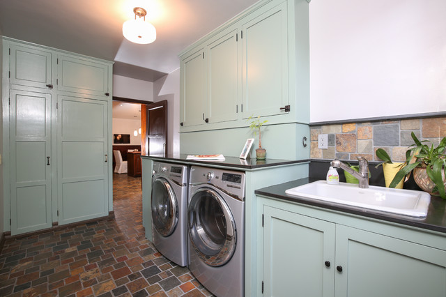 Whirlpool Stackable Washer and Dryer Laundry Room Traditional with Basalt Counter Custom Sink
