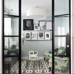 Ra the Rugged Man with Contemporary Living Room and Glass and Metal Doors