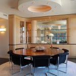 8 Round Rugs with Contemporary Dining Room and  Wood Flooring     Round Rug  Wall Lighting  Round Dining Table  Glass Shelves
