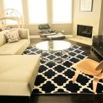8 Round Rugs with Contemporary Family Room and  Glass Coffee Table  Corner Fireplace  Neutral Colors  Sectional Sofa     Round Coffee Table