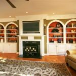 9x12 Area Rugs with Traditional Living Room and  Crown Molding  Fireplace  Recessed Lighting  Arched Cabinets  Accent Paint