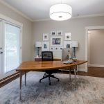 9x12 Area Rugs with Transitional Home Office and  Rolling Blinds  White Crown Molding     Console Table  Dark Hardwood Floors  Freestanding Desk