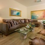 Animal Skin Rugs with Contemporary Family Room and  Wall Decor  Wood Flooring     Corner Sofa  Leather Sofa  Serving Tray