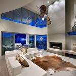 Animal Skin Rugs with Contemporary Living Room and  White Leather Couch     Clerestory Window  Animal Skin Rug  Gas Fireplace  High Ceiling