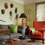 Animal Skin Rugs with Eclectic Living Room and  Grey Sofa  Hand Statue  Woven Wood Shades     Green Accents  Contemporary Wing Chair