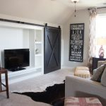 Animal Skin Rugs with Farmhouse Family Room and  Barn Doors  Black Barn Doors  Animal Skin Rug  Black and White  Cow Hide Floor Rug