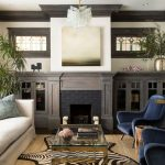 Animal Skin Rugs with Transitional Living Room and  Craftsman  Crown Molding  Neutral Tones  Modern Furniture  Blue Chair