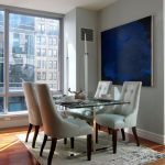 Area Rug Sets with Modern Dining Room and  White Leather Dining Chairs  Gray Walls  Wood Floor     Tufted Upholstery  Area Rug