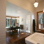 Bfg Rugged Terrain with Rustic Bathroom and  Clapboard  Sconces  Concrete Columns  San Juan Islands  White Paneling