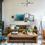 Bfg Rugged Terrain with Transitional Living Room and  Green Tufted Sofa  Orange Armchair  Blue and White Rug  Reclaimed Wood Coffee Table     Industrial Pendant Light