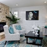 Blue Area Rugs with Contemporary Living Room and  White Table Lamp  Blue Accents  Black Coffee Table  Stone Fireplace  Fireplace Cutouts