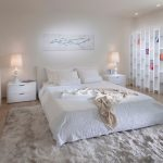 Claire Murray Rugs with Contemporary Bedroom and  Upholstered Headboard  Table Lamps  Monochromatic  White Bedroom  Wood Flooring
