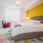Colorful Area Rugs with Contemporary Bedroom and  Recessed Lighting  Pink and Yellow  Colorful Area Rug  High Ceilings  Yellow Feature Wall