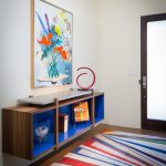 Colorful Area Rugs with Contemporary Entry and  Framed Artwork  Bright Color  Floating Cabinet  Colorful Area Rug  Contemporary Decor
