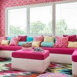 Colorful Area Rugs with Contemporary Kids and  Yellow Throw Pillows     Colorful Area Rug  Bright Pink Wallpaper  Bright Pink Seat Cushions  White Framed Windows