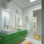 Colorful Area Rugs with Midcentury Bathroom and  Floating Green Vanity  Bright Colors  Vessel Sinks  Skylights  Wall Lights