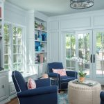 Colorful Area Rugs with Traditional Sunroom and  Built in Bookcases  Navy Blue Chairs  Built Ins  Colorful Area Rug  Ottoman Coffee Table